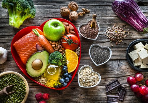 Healthy eating: group of fresh multicolored foods to help lower cholesterol levels and for heart care