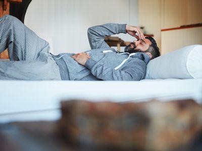 Man lying down with headache