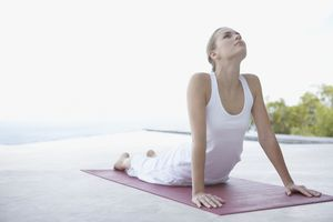 Photo of a woman performing the upward dog yoga position.