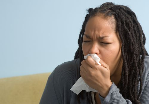 African American woman coughing
