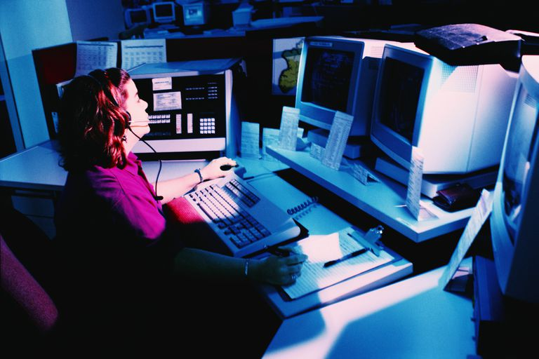 Woman working at police dispatch terminal