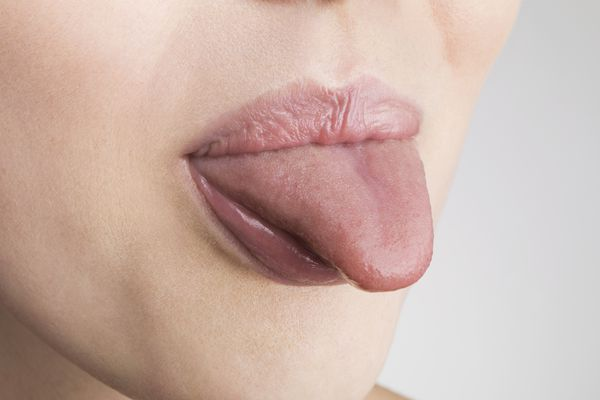 A woman sticks out her tongue