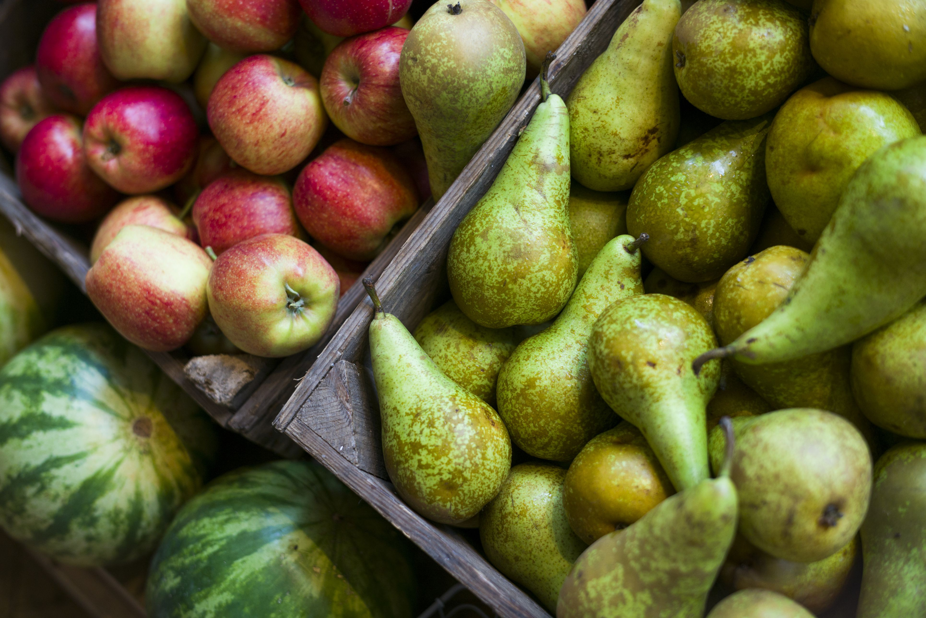Apples and pears on display for sale