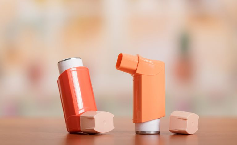 Two inhalers sitting on a table