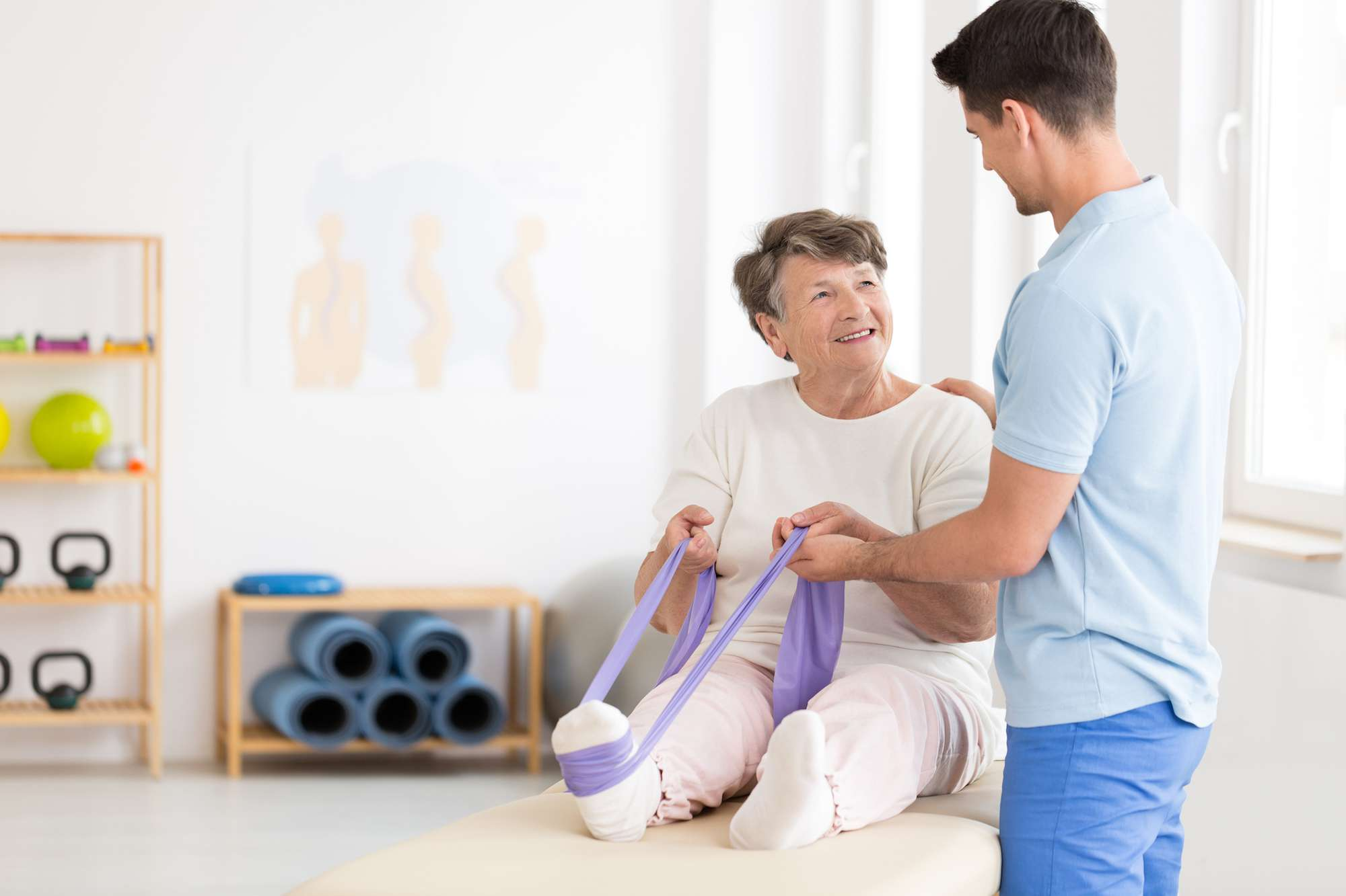 Woman going through physical therapy with doctor