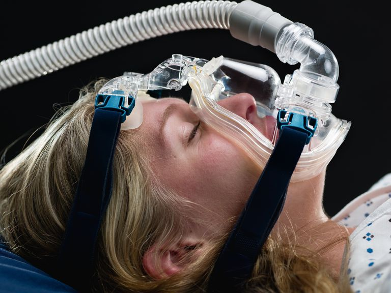 Woman wearing a CPAP mask