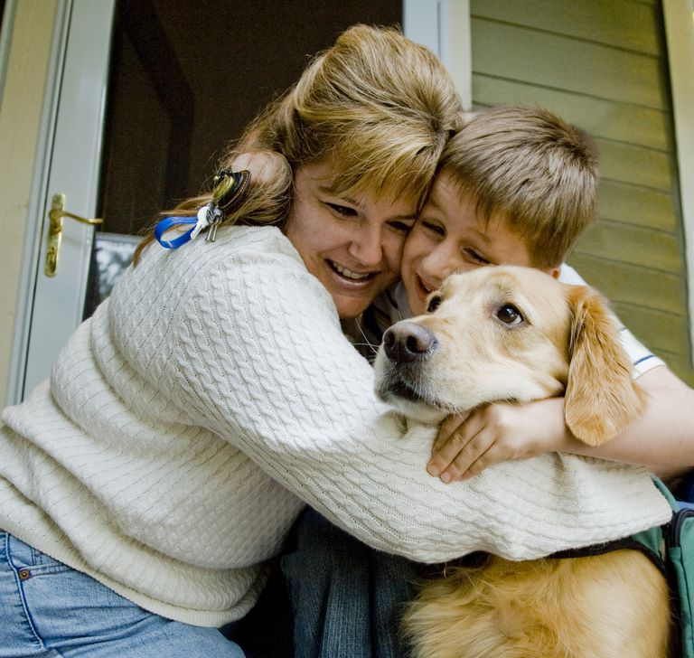 Mom and autistic son with guide dog