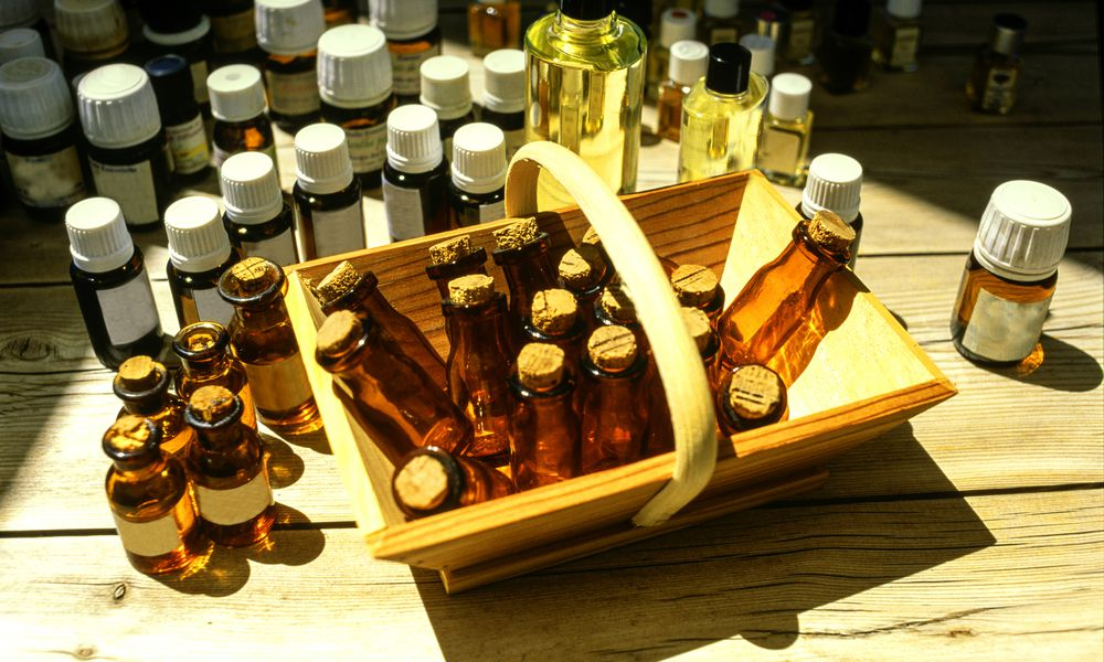 alternative medicines in a basket and on a table