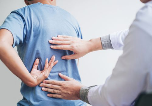 Man with back pain being examined
