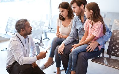 Doctor discussing with girl's family at hospital