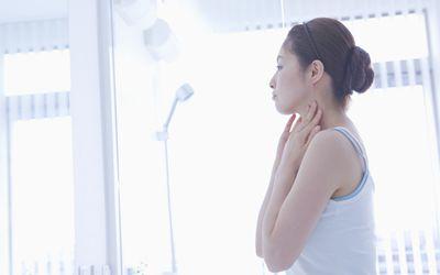 woman looking in mirror
