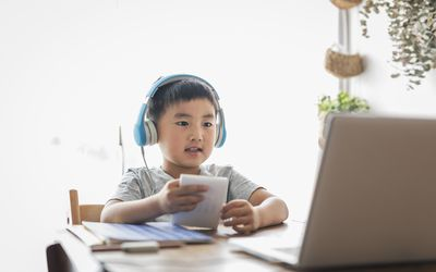Child learning on a computer