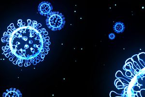 Concept art of glowing blue COVID virus particles on a black background.