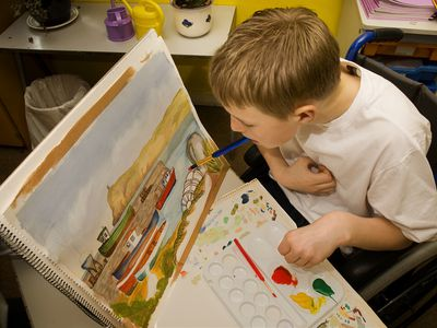 Boy with cerebral palsy paints pictures using his mouth