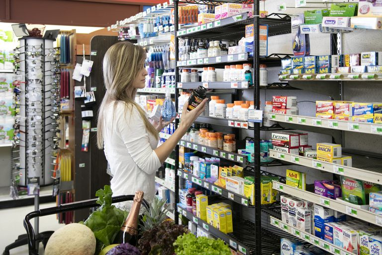 Woman shopping in the supplement aisle