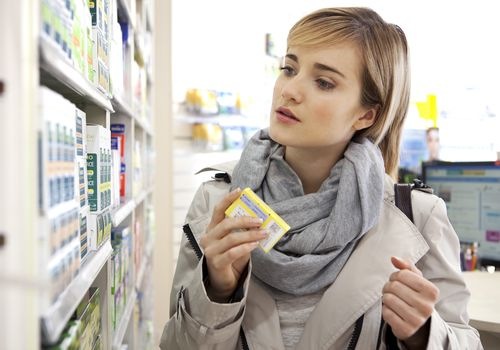Woman in drugstore shopping for medicine