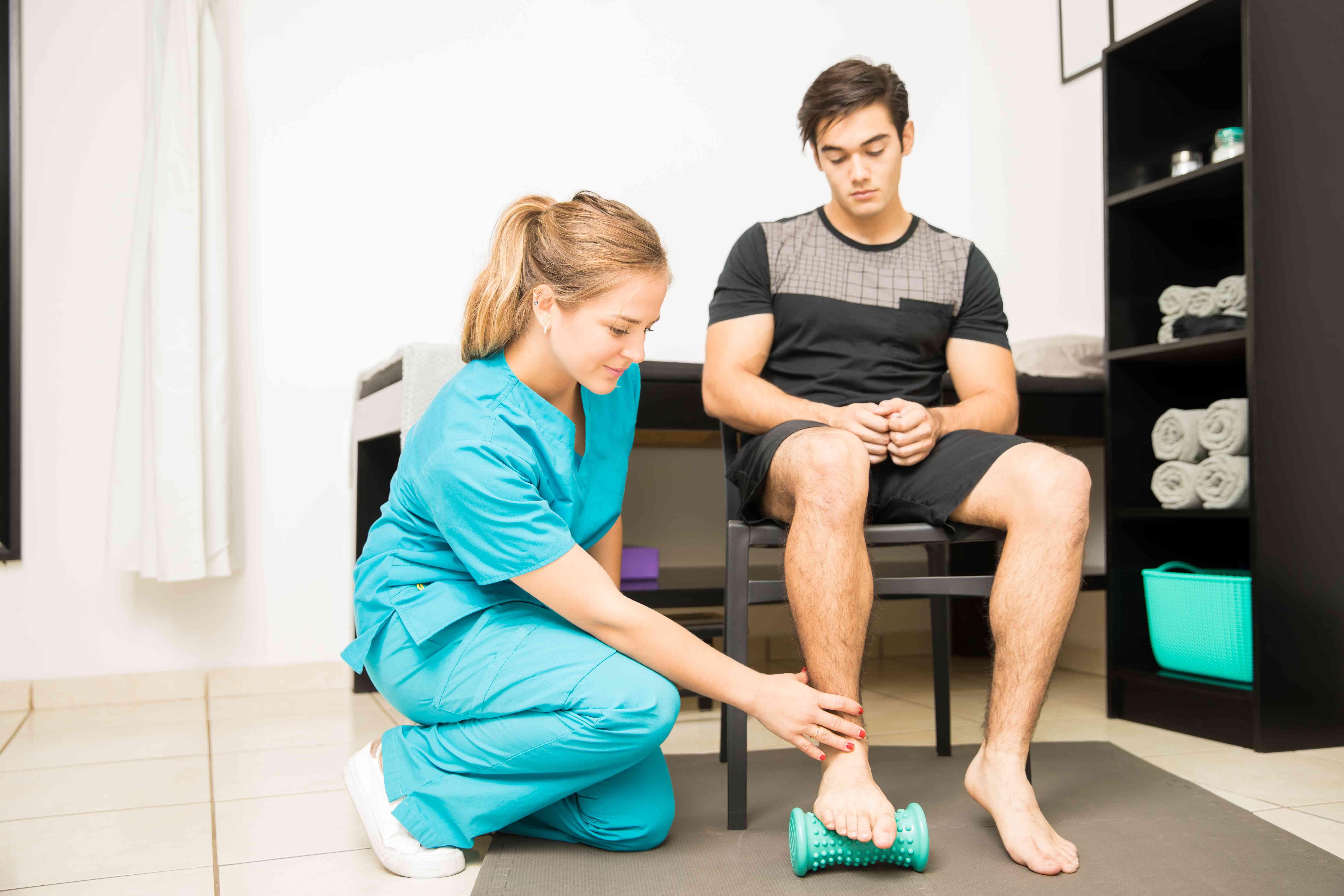 Physiotherapist Treating Plantar Fasciitis In Athlete