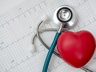 Red heart shown beside a stethoscope and EKG chart.