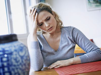 Woman with headache, France