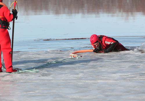 Rescuers practicing an ice rescue