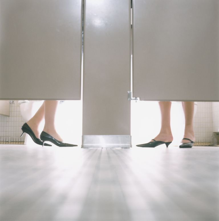 Feet of Women in Toilet Stalls