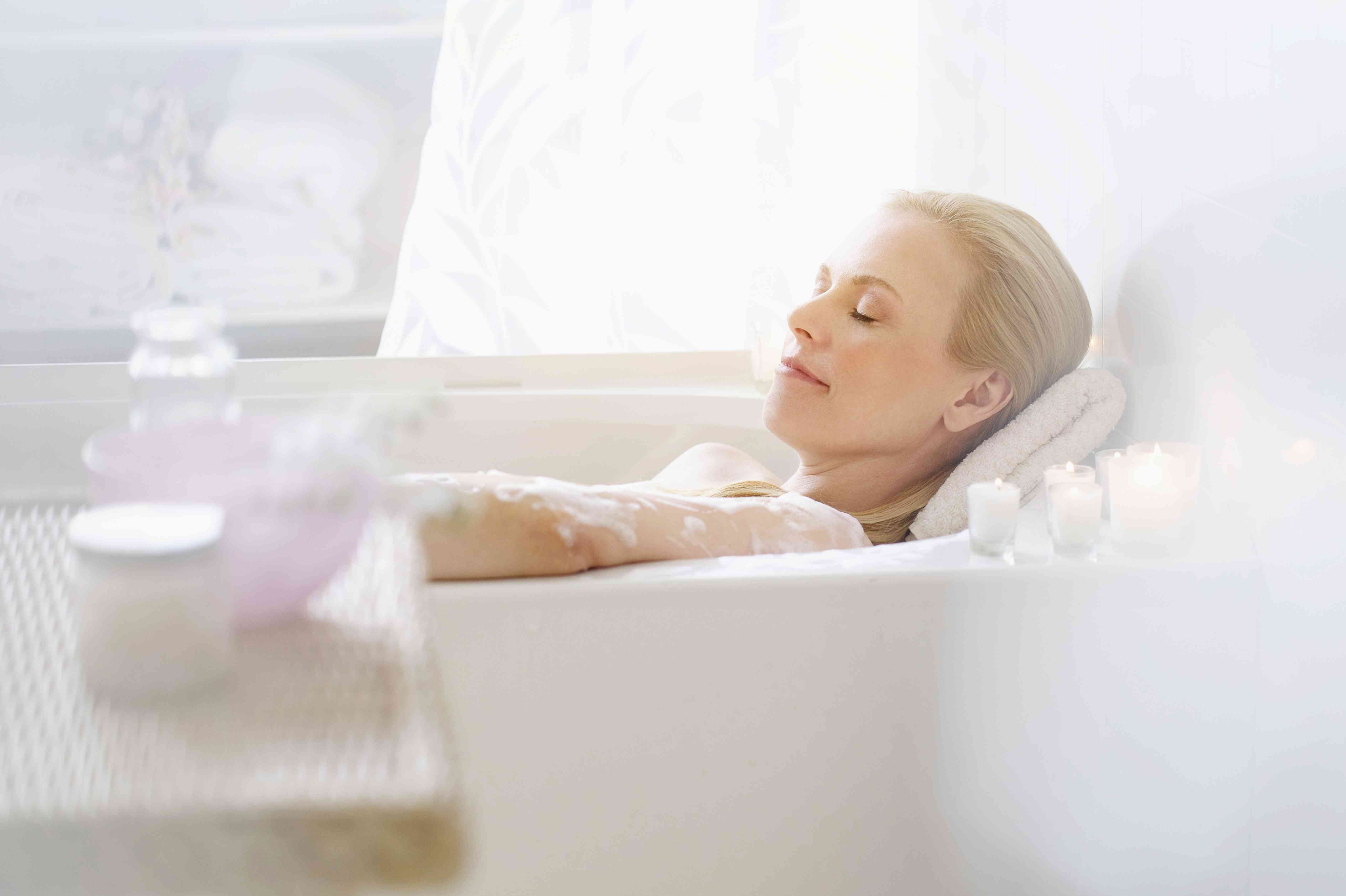 A woman relaxes in the bathtub