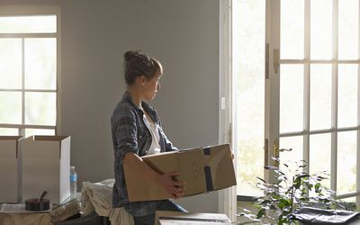 Woman moving out of home.