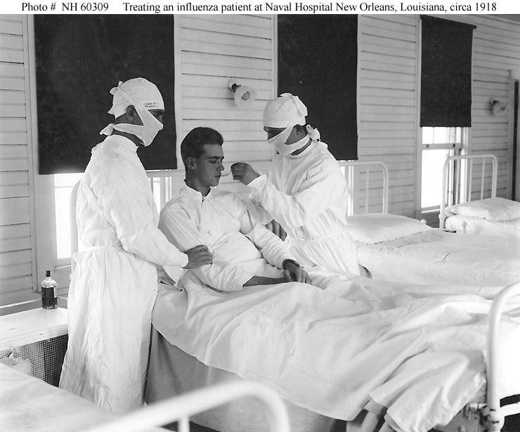 A picture of people giving treatment to an influenza patient during the 1918 Spanish flu pandemic.