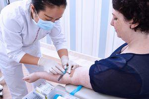 Nurse performing a blood test