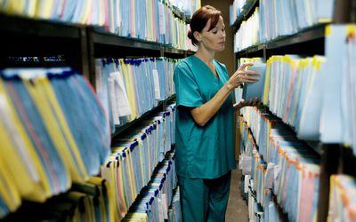 nurse in a medical file storage room