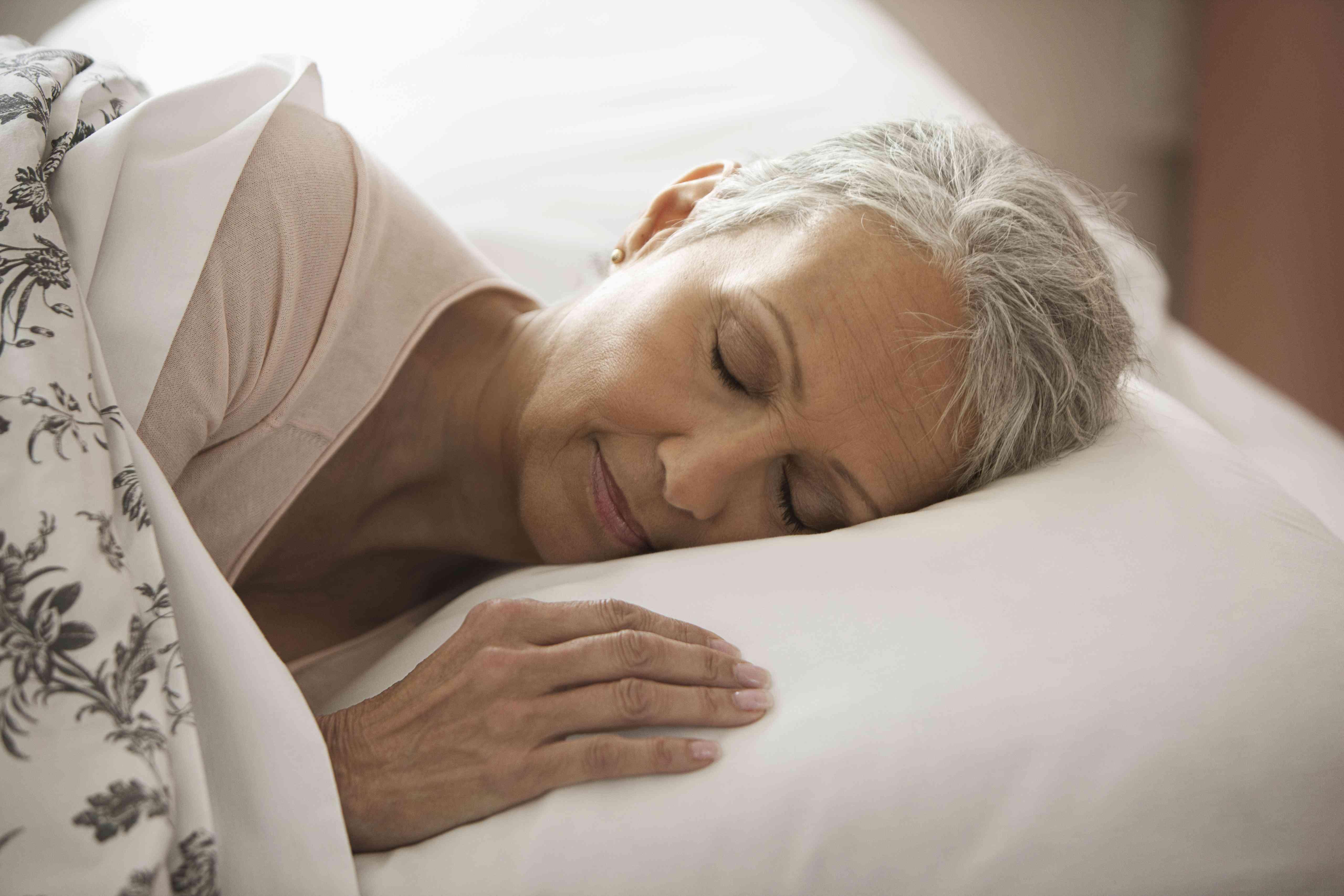 Older woman sleeping in bed