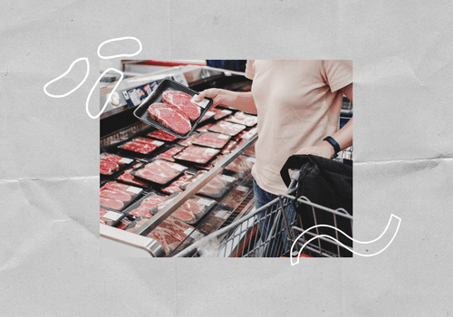 Woman buying red meat at the grocery store.