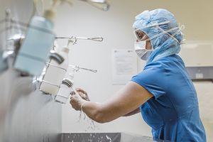 Female nurse washing hands to avoid COVID-19.