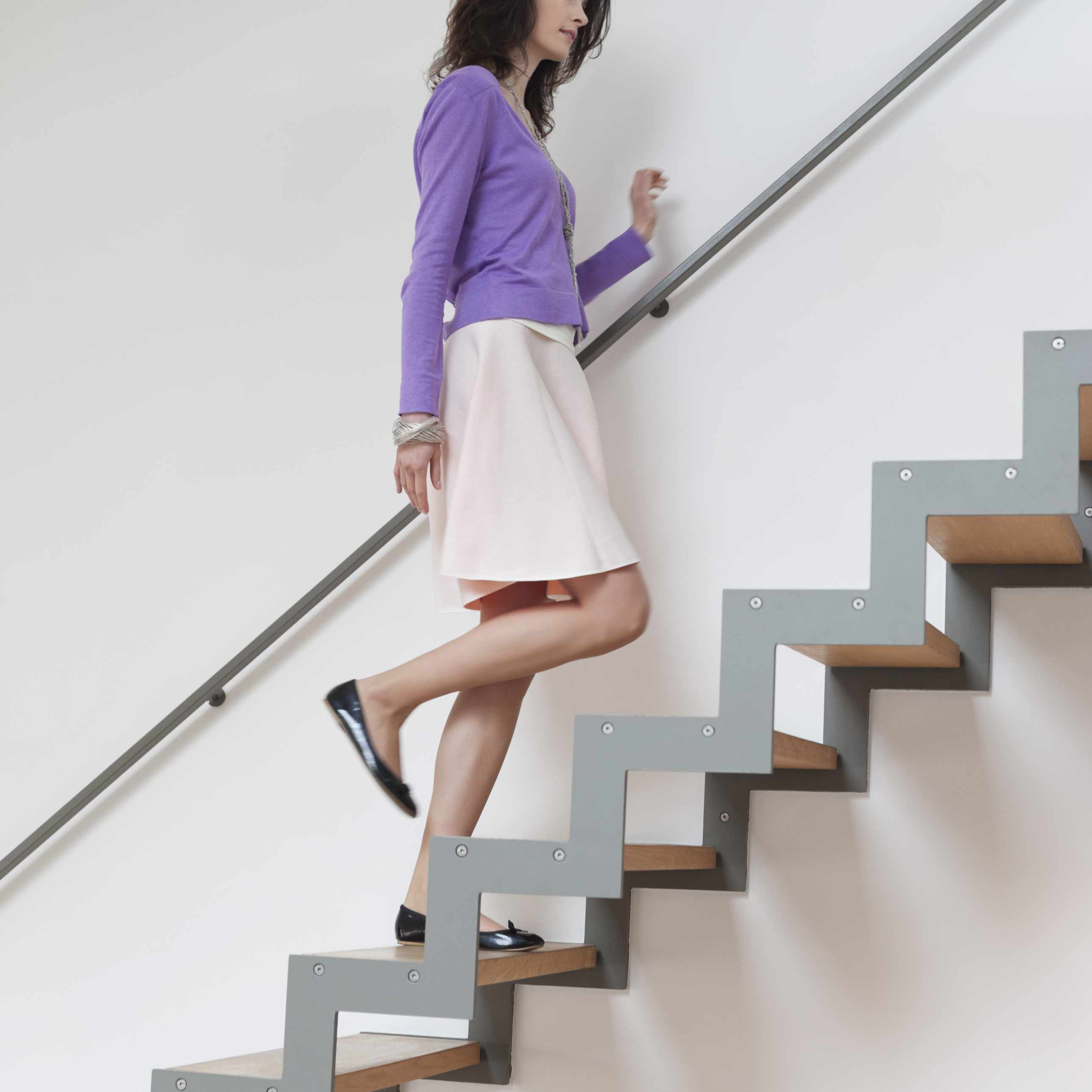 Woman-moving-up-stairs-ONOKY-Fabrice-LEROUGE-Brand-X-Pictures.jpg