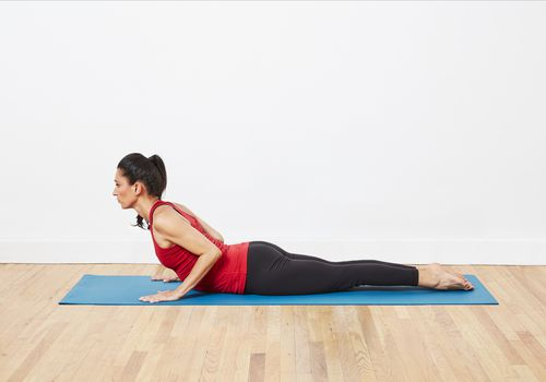 woman doing cobra pose