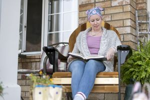 Woman with cancer relaxes on patio