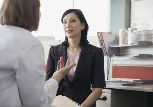 doctor talking with woman