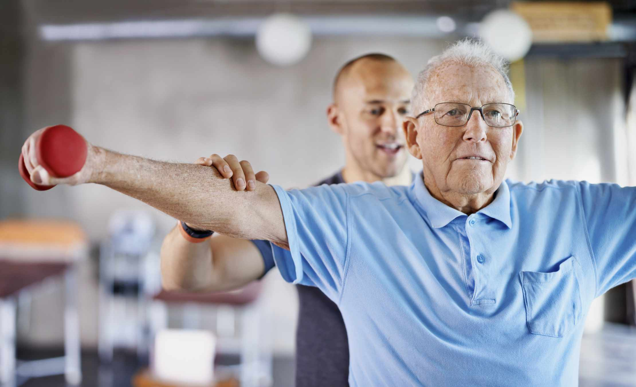 Man completing physical therapy in gym