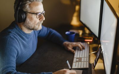 a man looking a computer