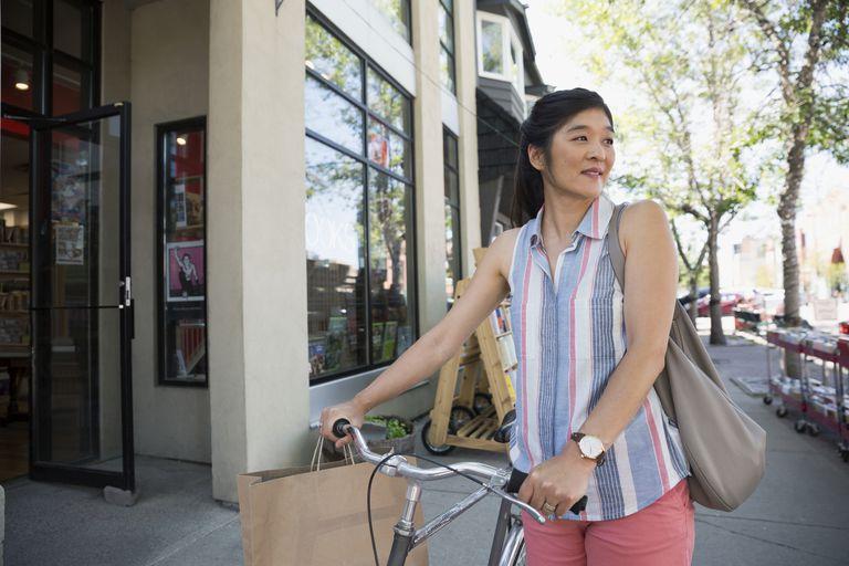 Woman walking with her bike