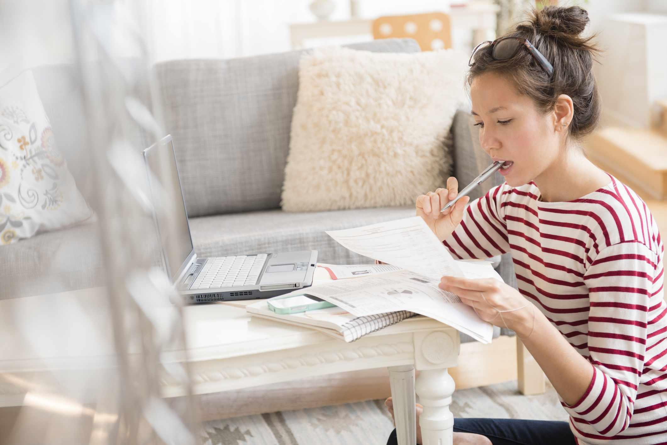 woman looking at credit card bills and credit health insurance