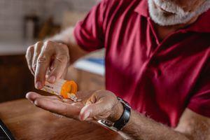 older man taking wellbutrin pills