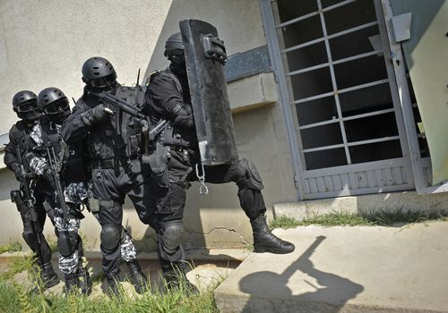 A swat team about to enter a home