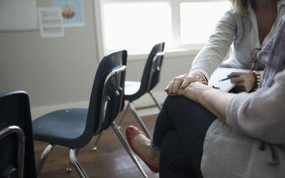 Grieving woman seeking comfort