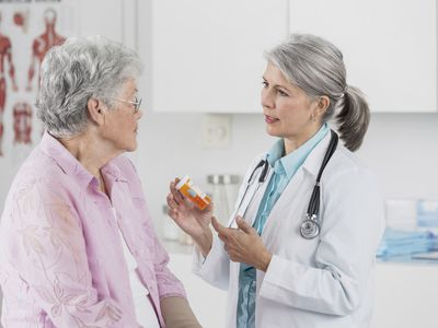 Caucasian doctor talking to patient in office