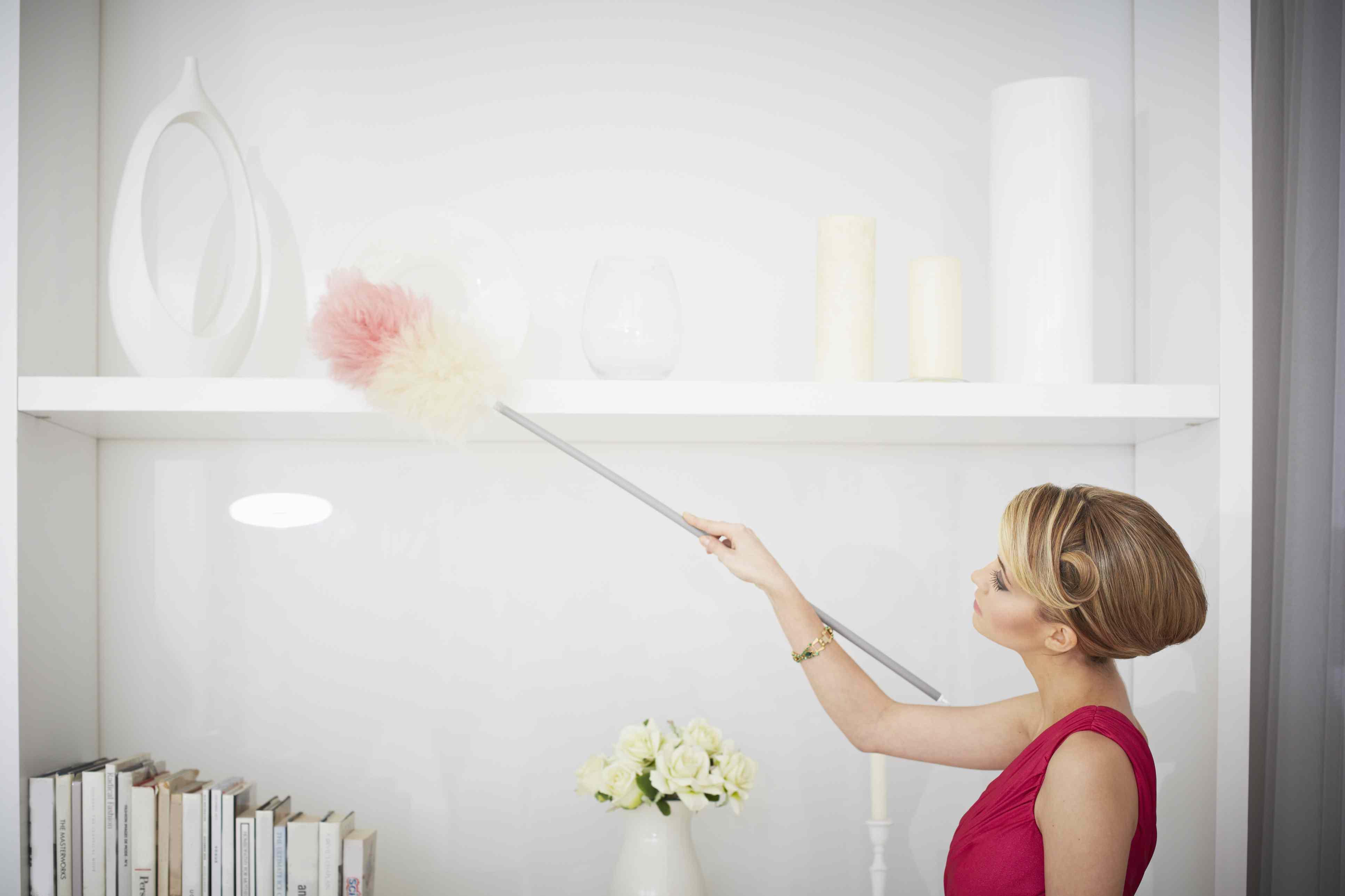 woman Dusting a high shelf
