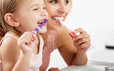 Mother child brushing teeth