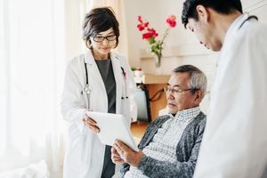 Doctors Explaining Test Results To Japanese Patient