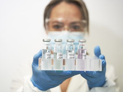 scientists holding vaccines