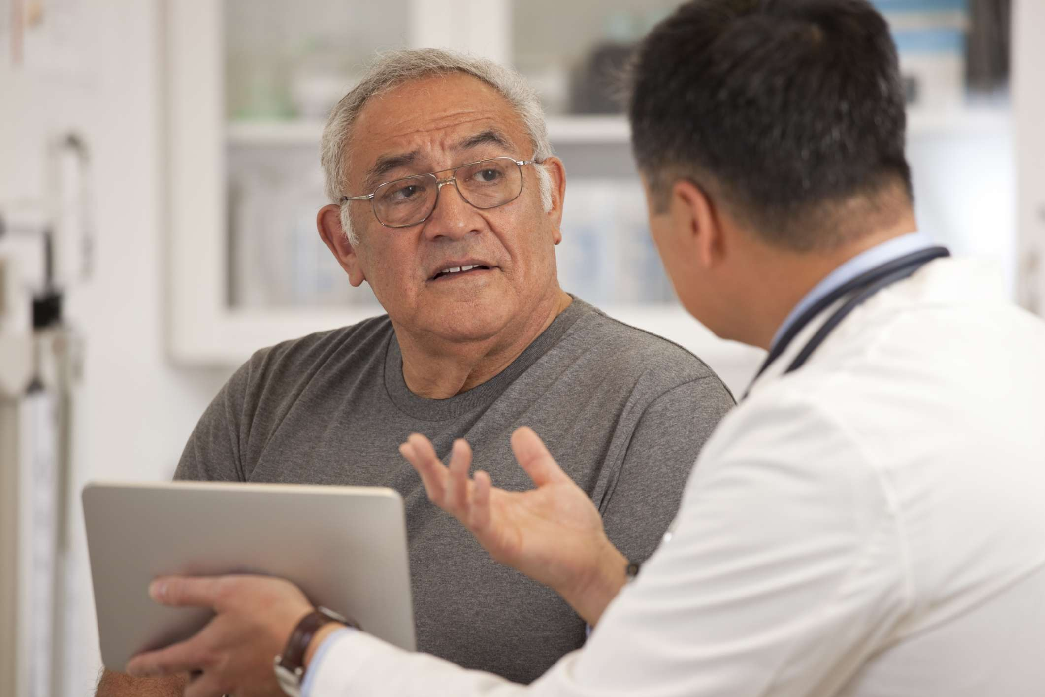 Doctor speaking with patient about medications and weight gain